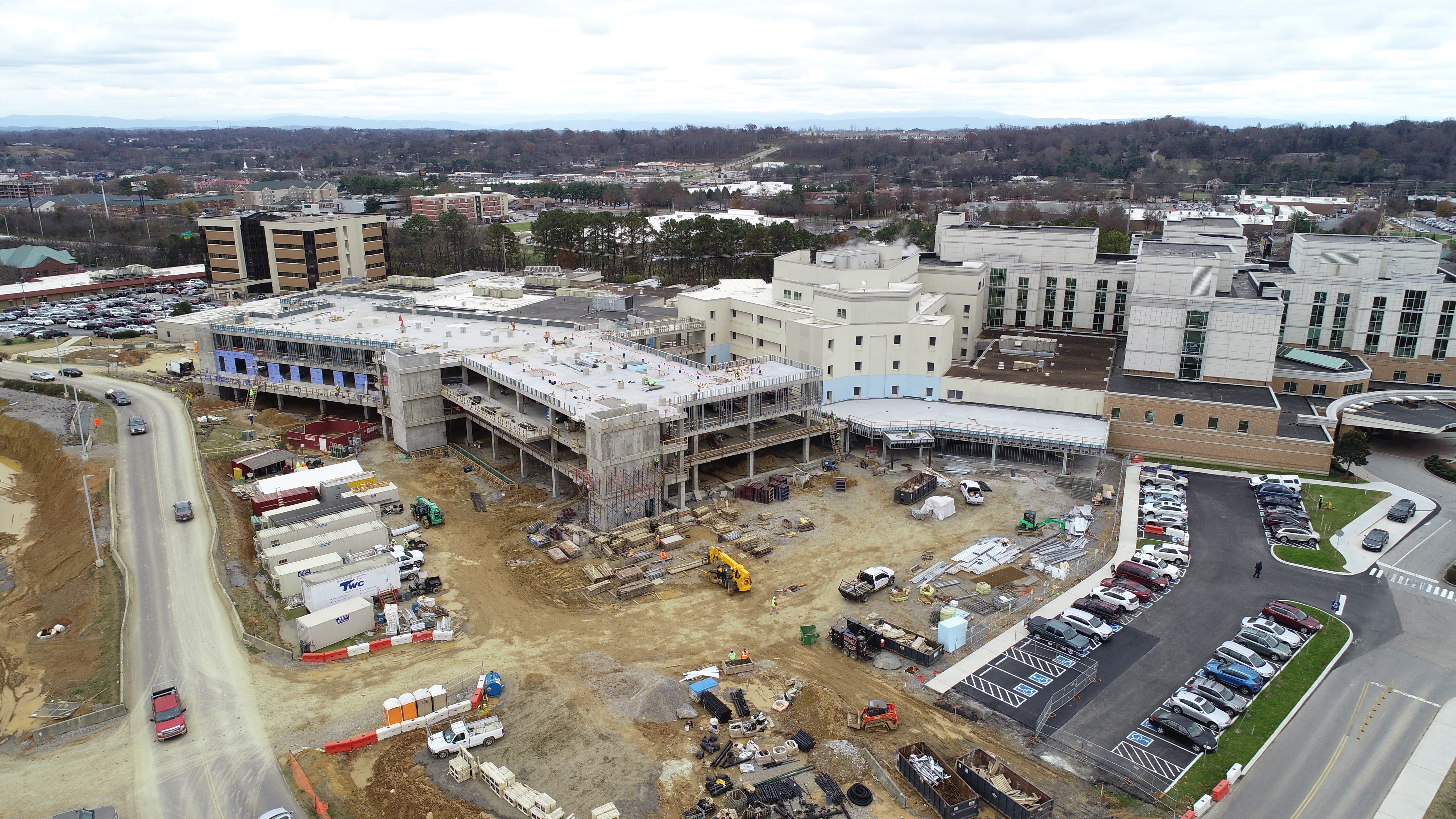 Aerial view of construction site tying in to existing building.