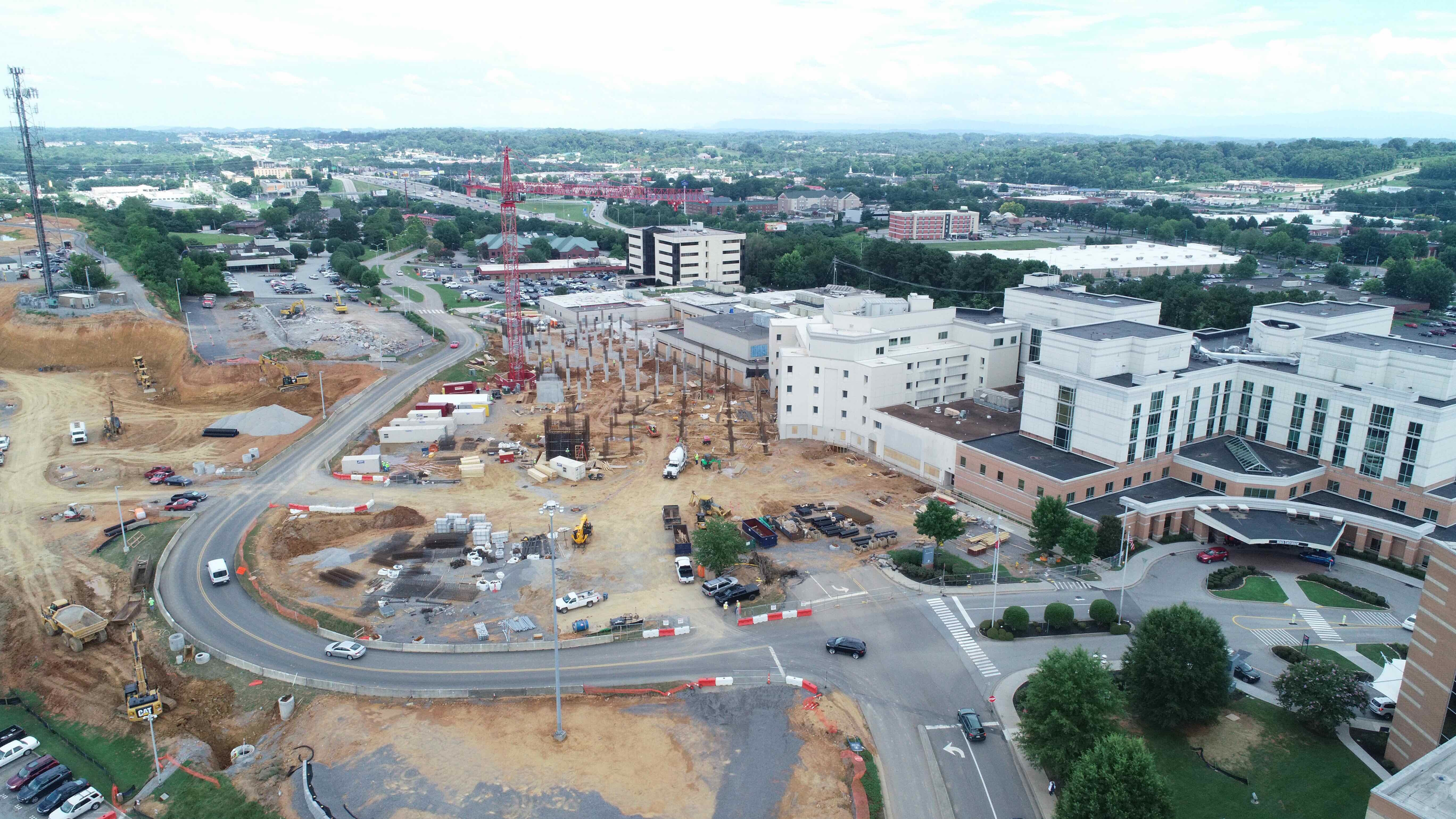 July progress showing pylons on soon-to-be construction site.