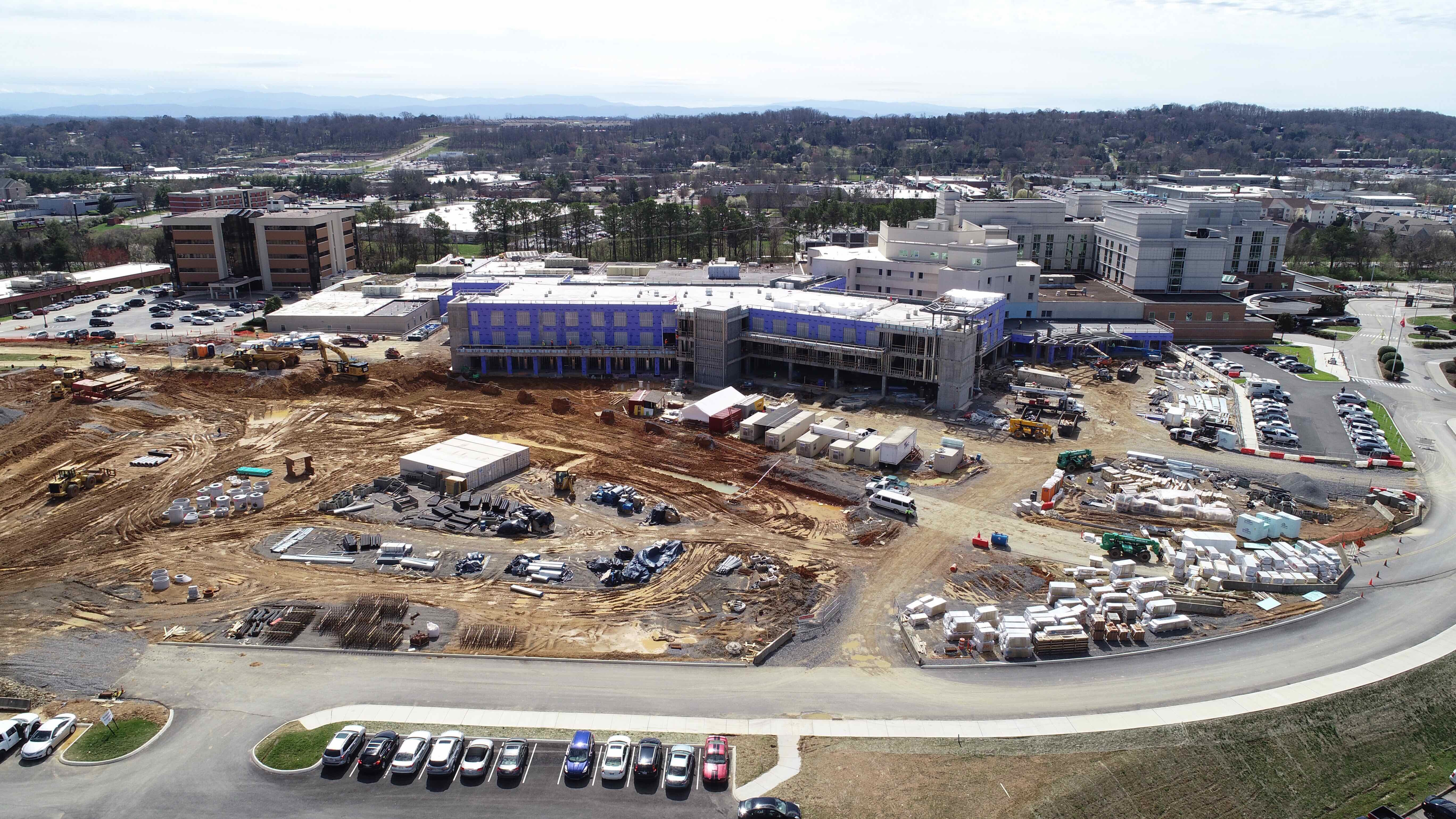Drone shot showing new tower and parking areas.