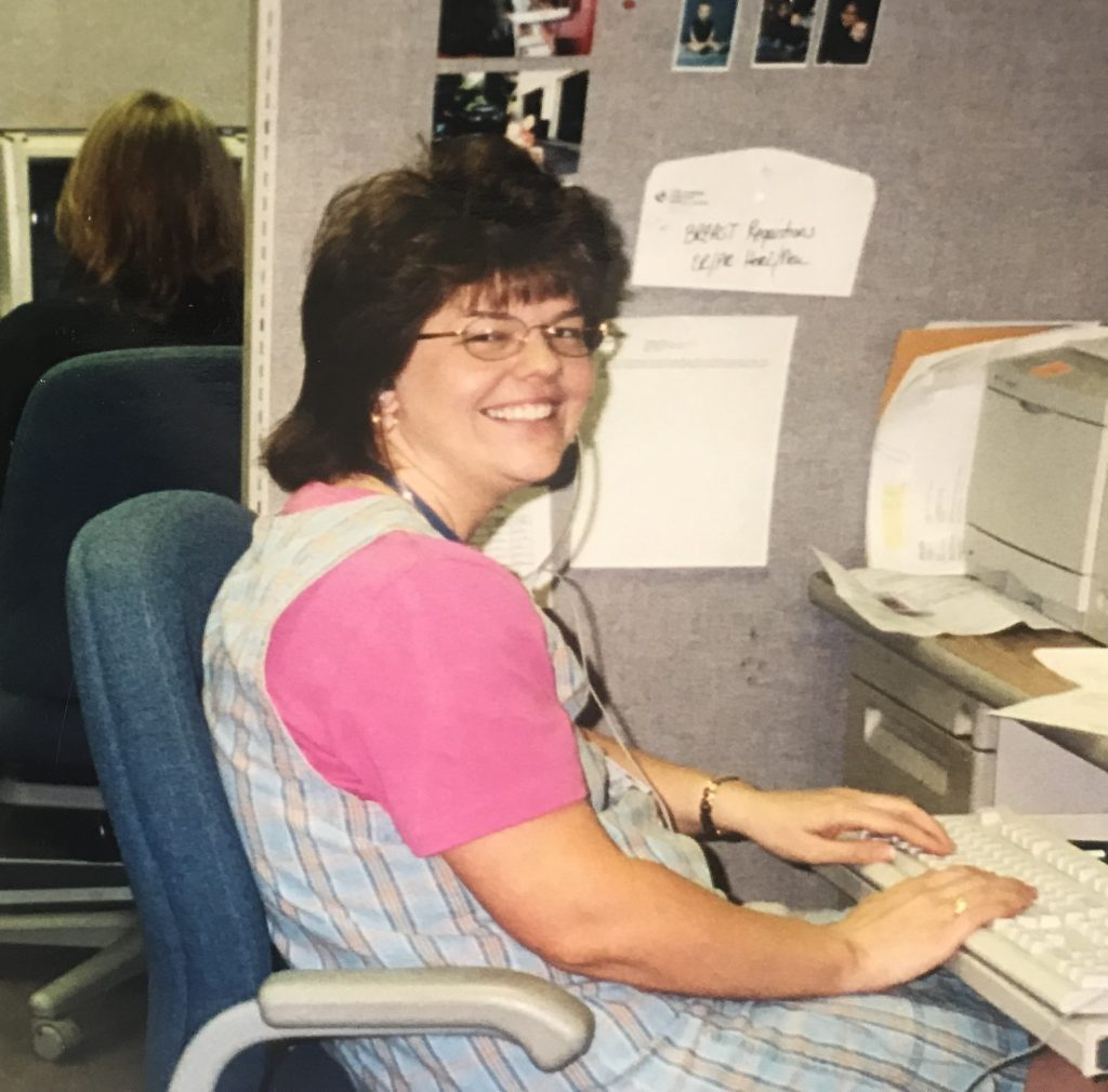 TBT of Vicki at work, typing on old computer keyboard.