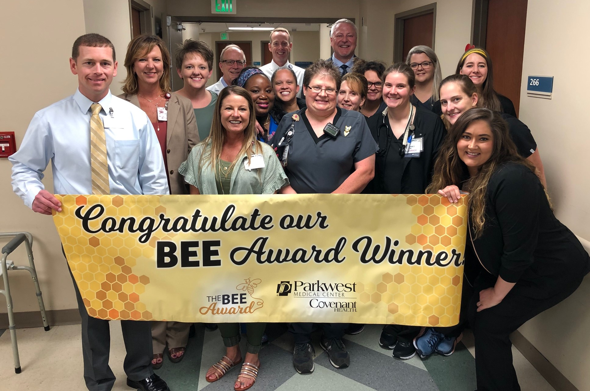 BEE Award committee and 2M staff congratulating Laurie Davis on her BEE award.