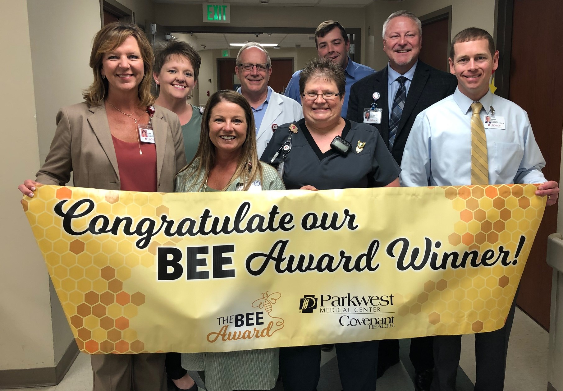 Laurie Davis receives BEE Award from the BEE committee.