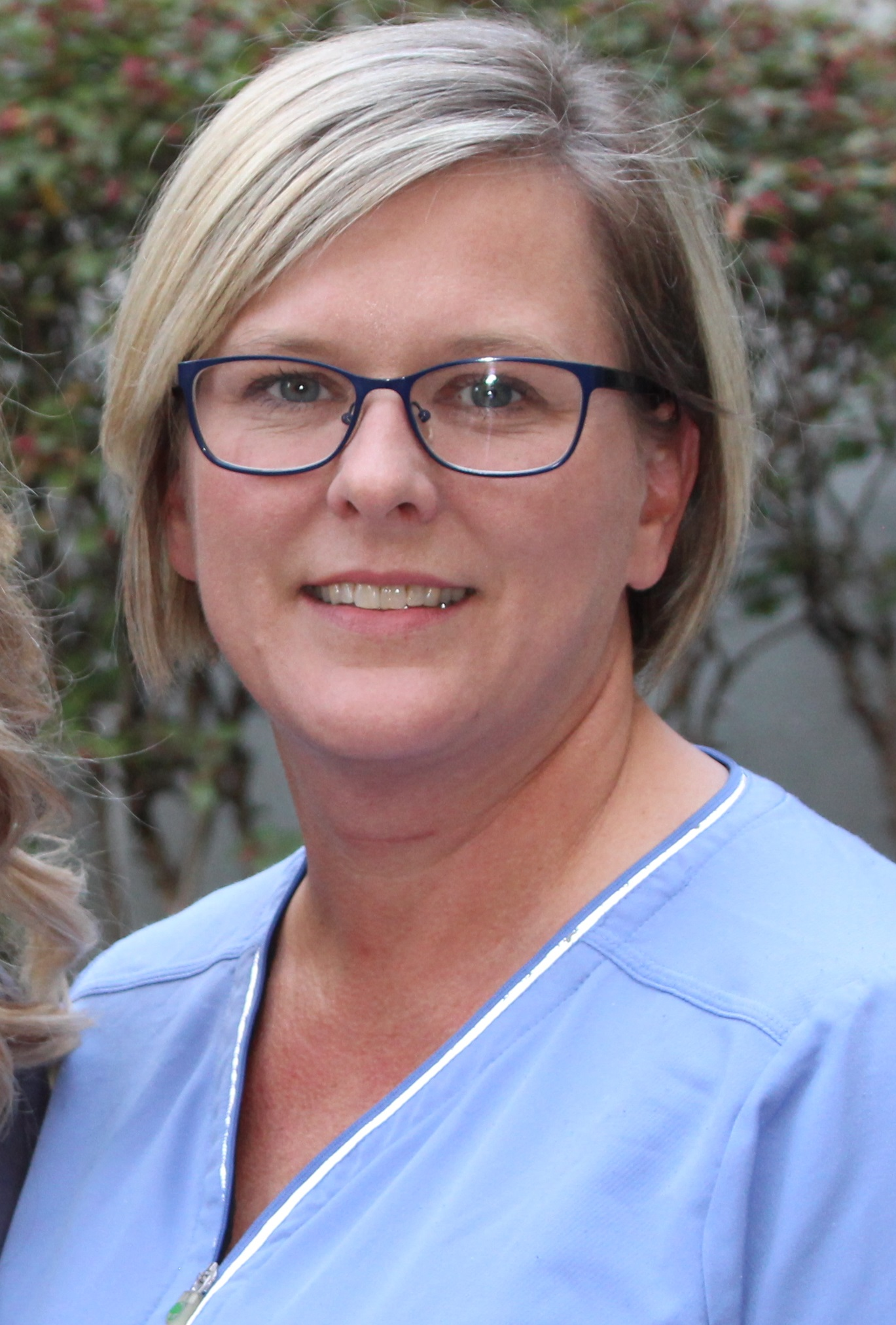 Misty Windle current in blue scrubs.