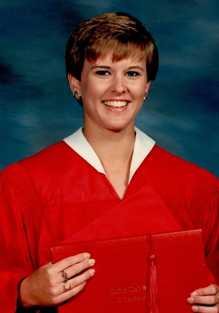 TBT: Misty Windle in red graduation gown holding diploma.