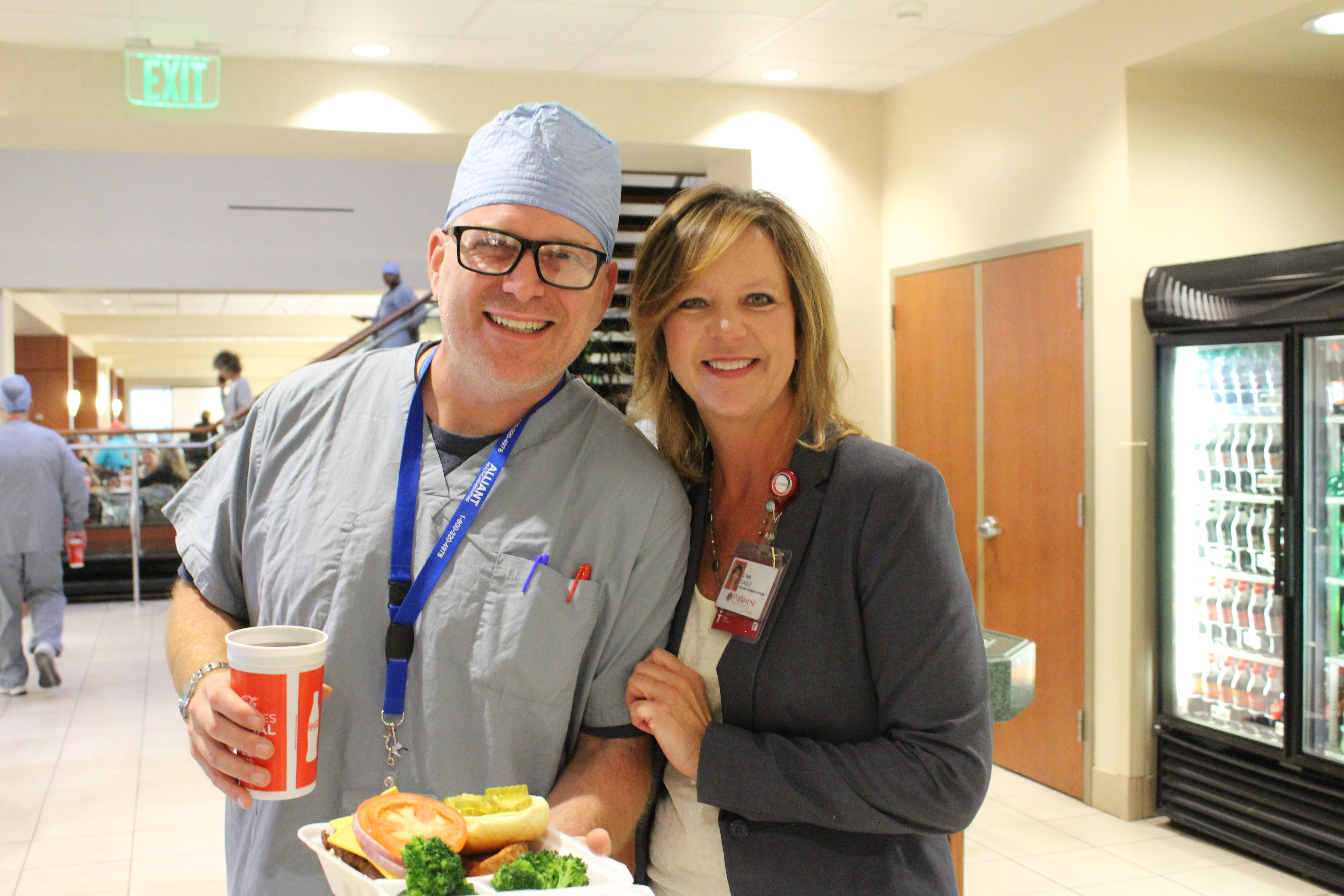 Nurse with Lynn cagle in cafeteria.