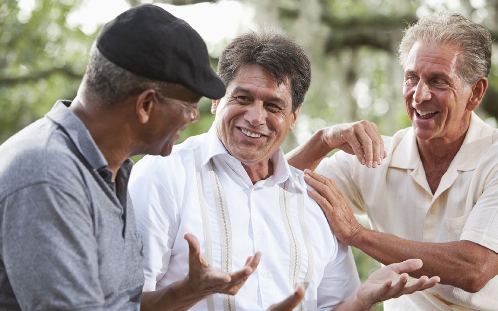 3 middle-aged men in animated conversation.