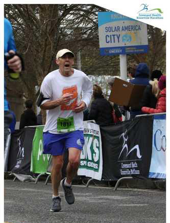Tom Fethe pictured finishing the Covenant Health Knoxville Half Marathon.