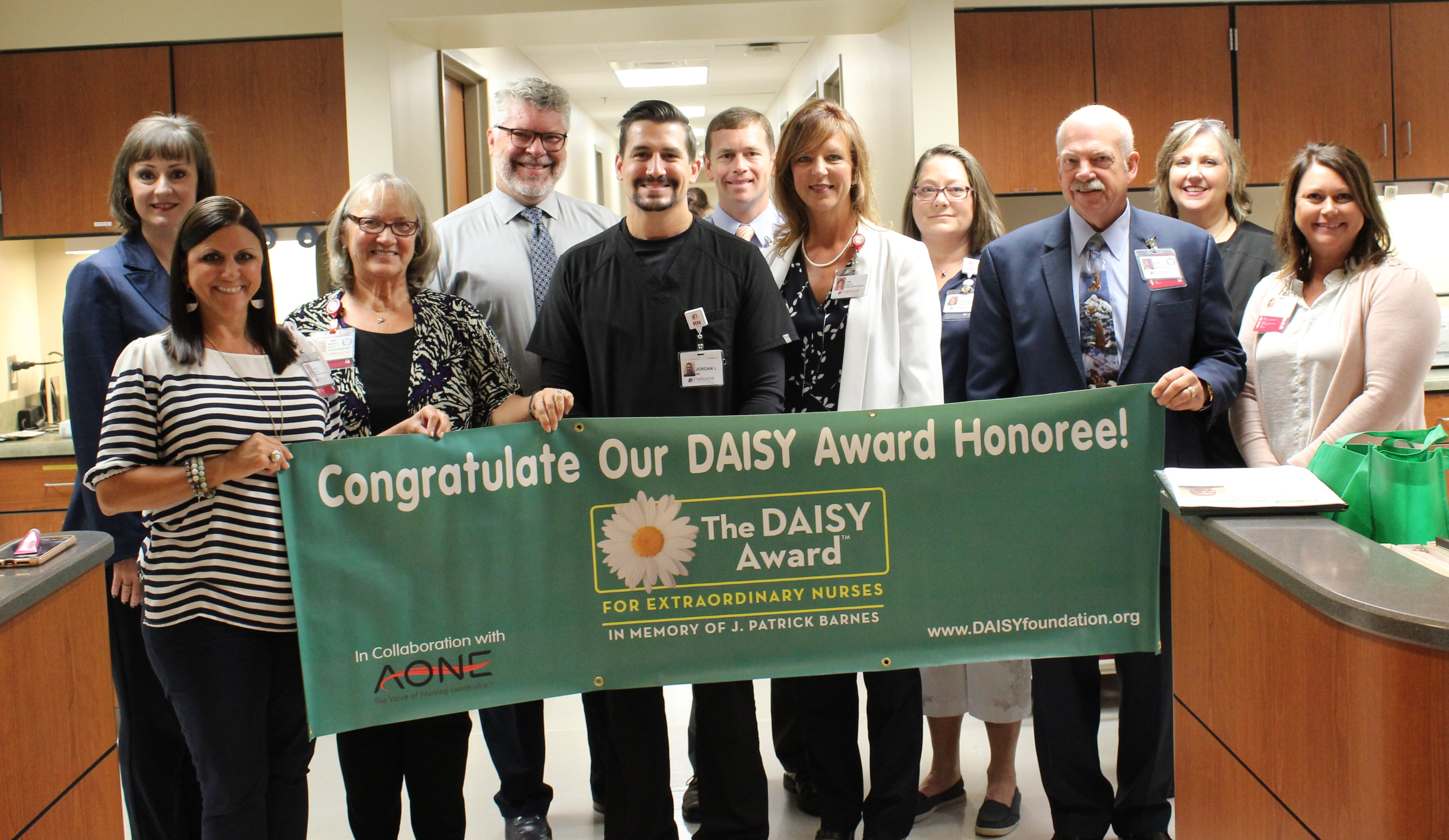 Jordan Lang is presented with the DAISY award.