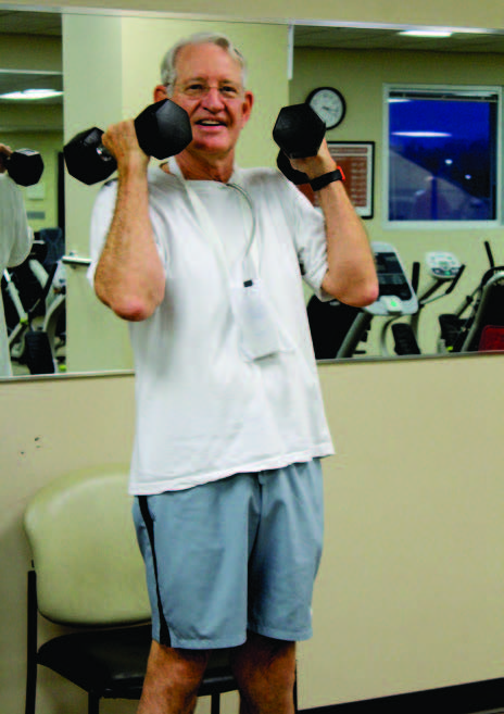 Dr. Ambrose lifting weights