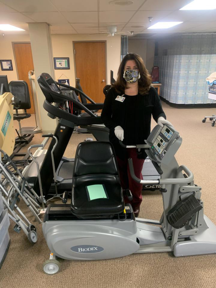 Jennifer Galloway in PT gym with mask on
