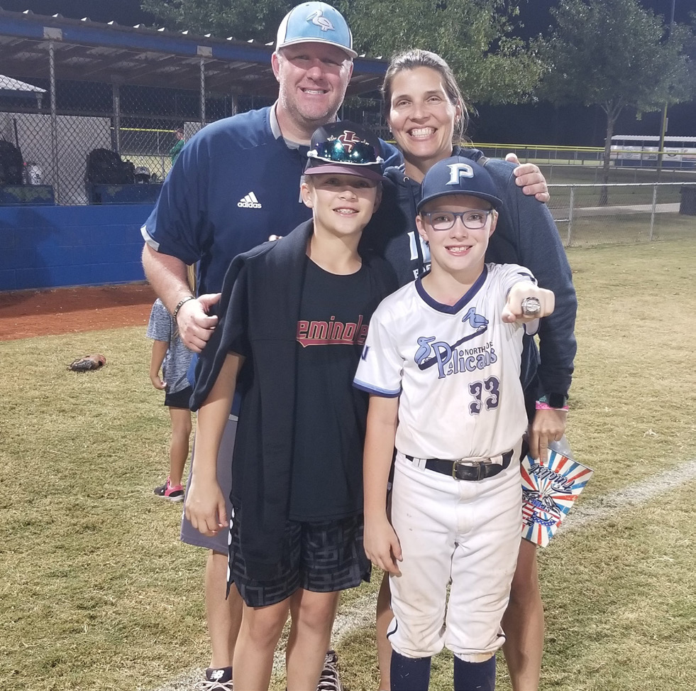Julie with her family on the baseball field