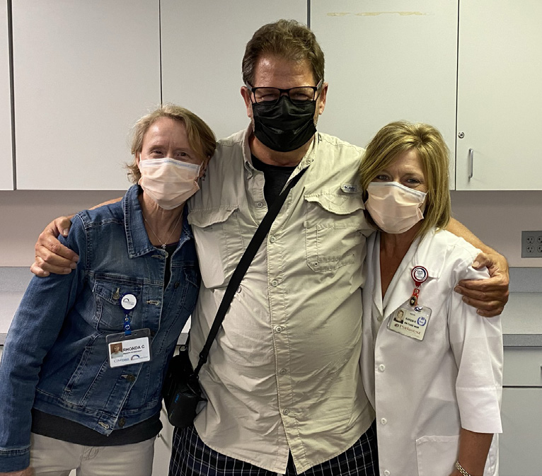 George Moore with Rhonnda Cloinger, MS, CCRP, exercise therapist, left, and Karen Kirkland, RN, certified case manager.