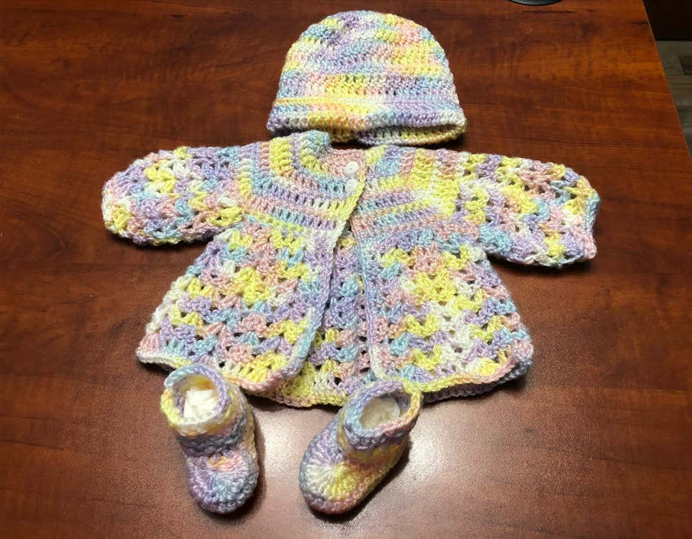 baby outfit crocheted by Freida.
